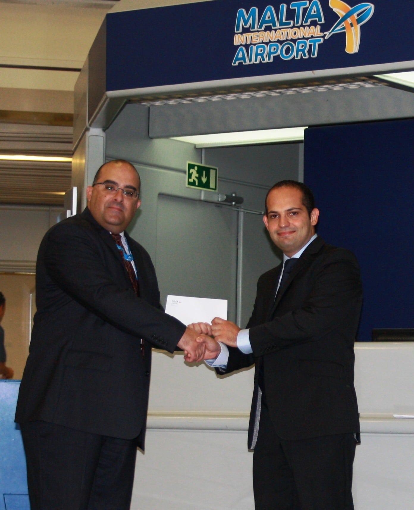 PR03-Reuben Sciberras presenting MIA sponsorship to Michael Formosa
