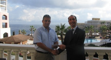 Director of Sales & Marketing Edward Bonello handing over the voucher to the winner