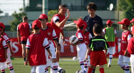 16 - Arsenal player Kieran Gibbs at a children's sports clinic in Japan