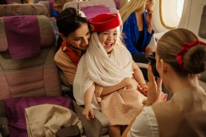 16 - the  popular instant photograph in an iconic Emirates cabin crew hat