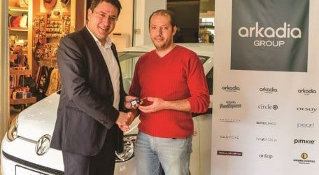 Left - Arkadia Group General Manager Antoine Portelli congratulating Noel Zammit on winning the Volkswagen Up