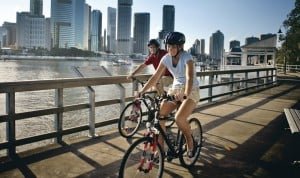 Brisbane - cyclists on the floating pathway along Brisbane River