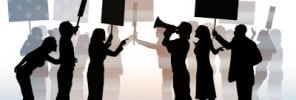 Silhouettes of people at political protest